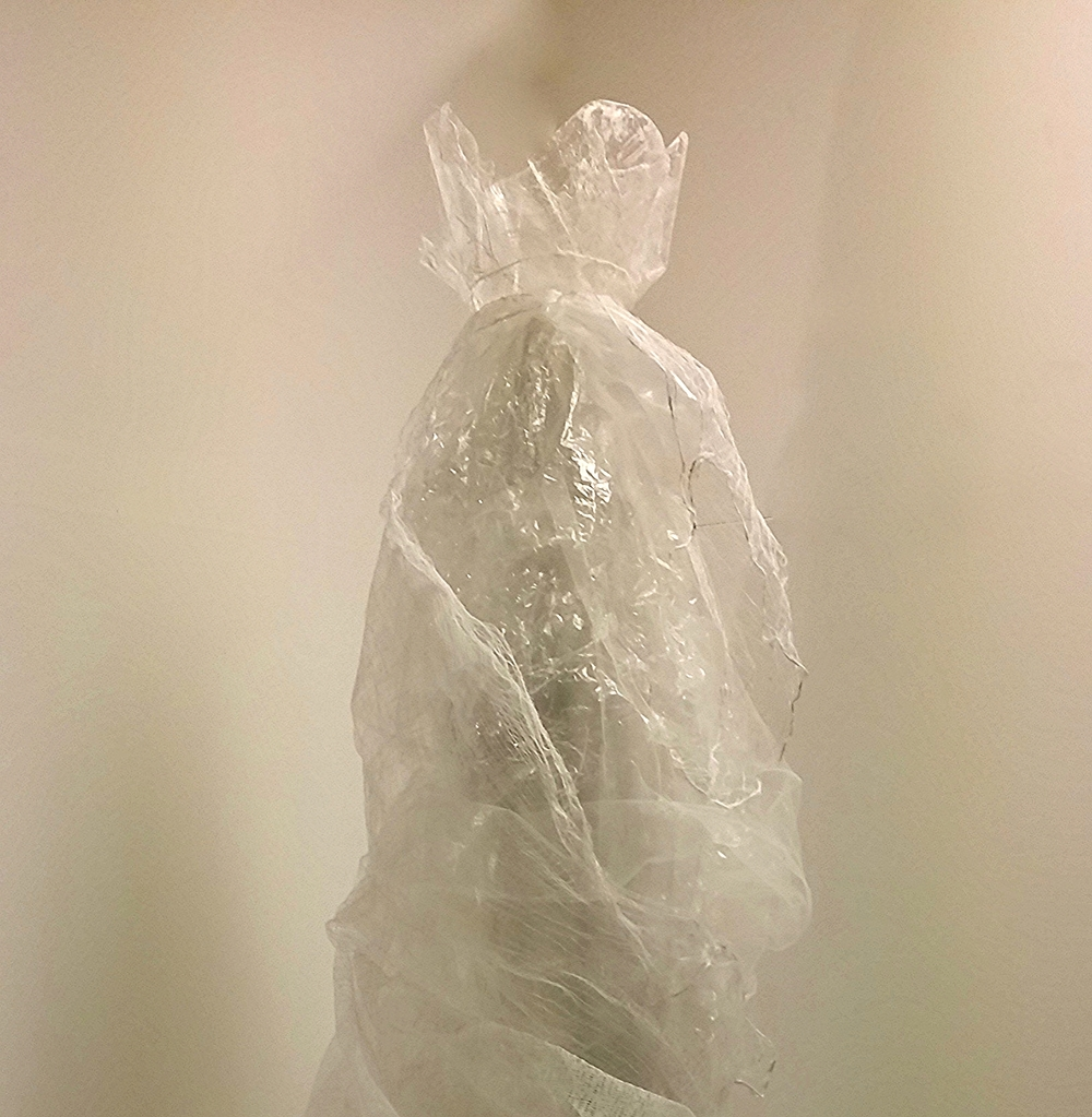 I, The Queen, 2016  84 X 28 x 26 inches  Plastic film, gauze, tulle, nylon thread, white glue, plexiglass tube on wood base