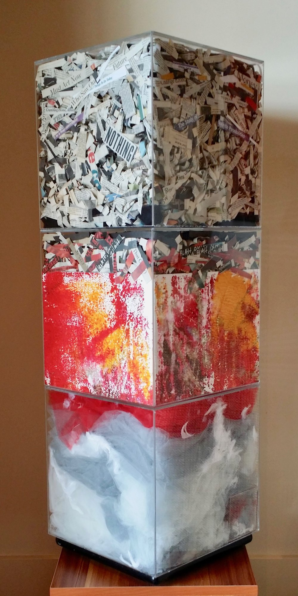 An Hypothesis, 2015  38 x 12.5 x 12.5 inches  Three acrylic cubes containing newspaper clippings, paintings, fabric