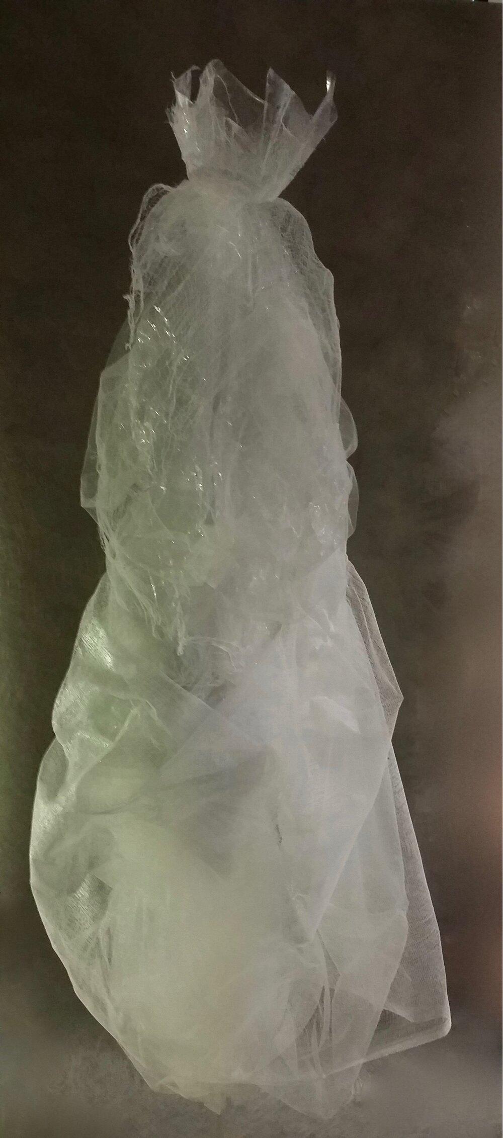 I, The Queen, 2016  84 X 28 x 26 inches  Plastic film, gauze, tulle, nylon thread,white glue, plexiglass tube on wood base
