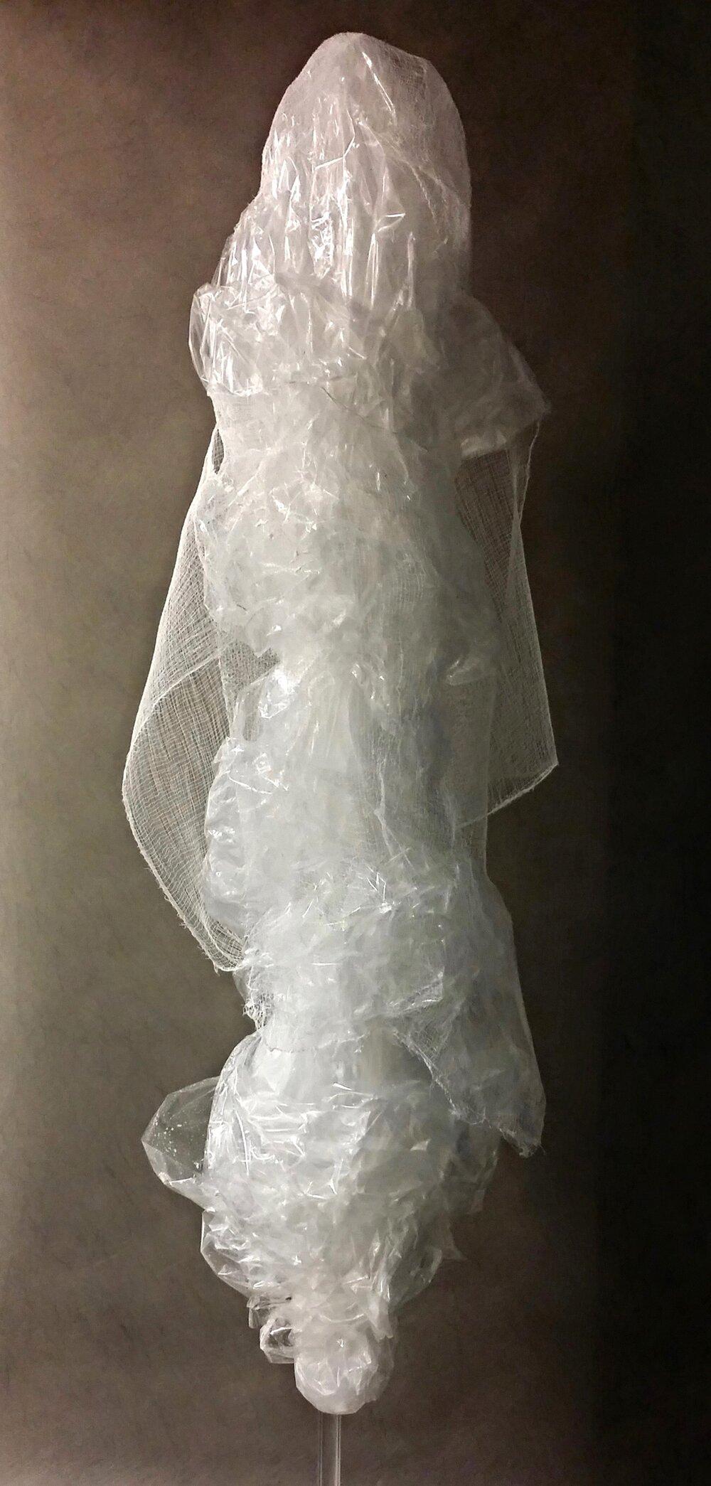 I, The King, 2016  80 x 20 x 18 inches  Plastic film, gauze, tulle, nylon thread,white glue, plexiglass tube on wood base