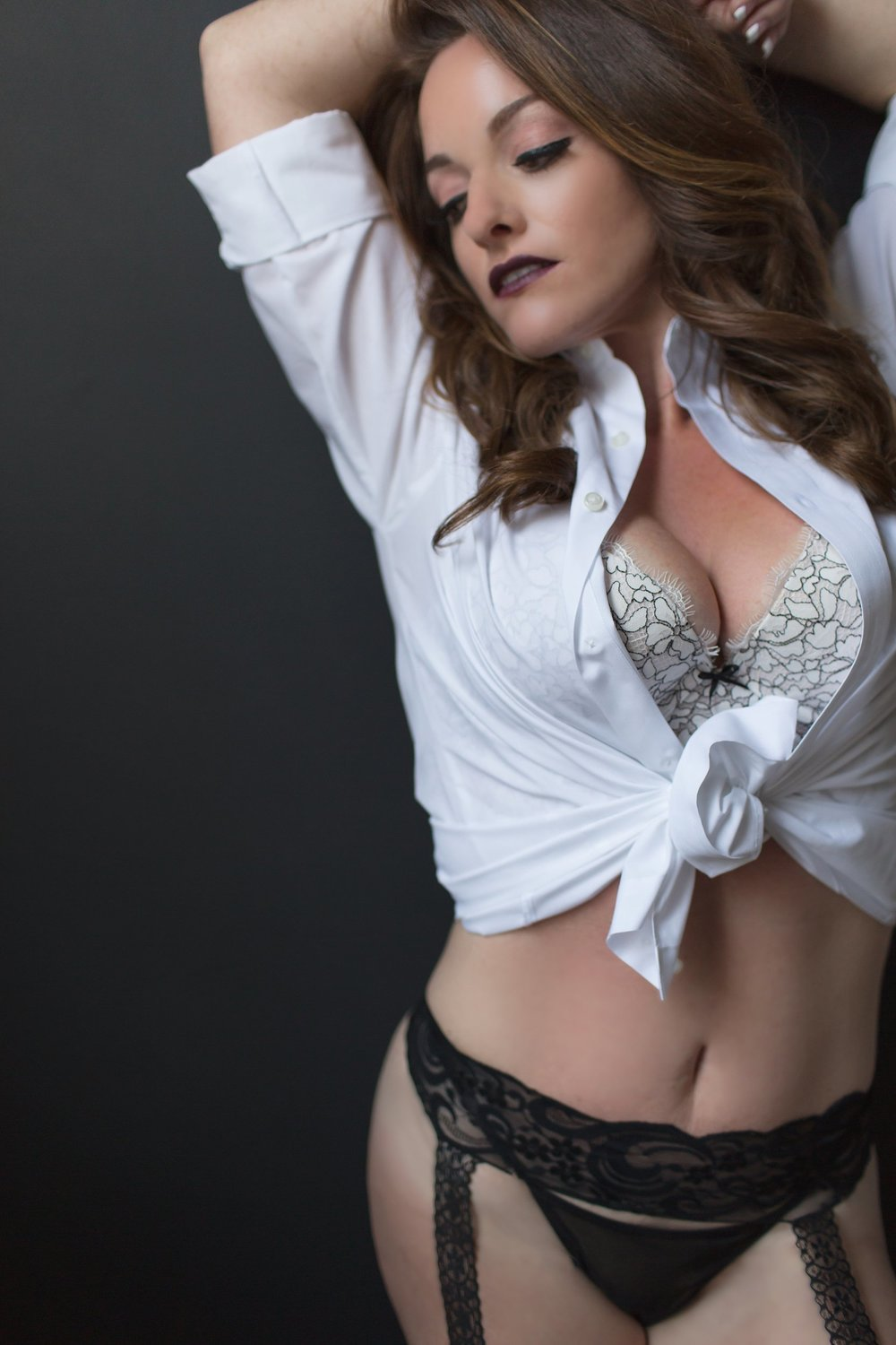 Sexy woman in men's dress shirt with garter
