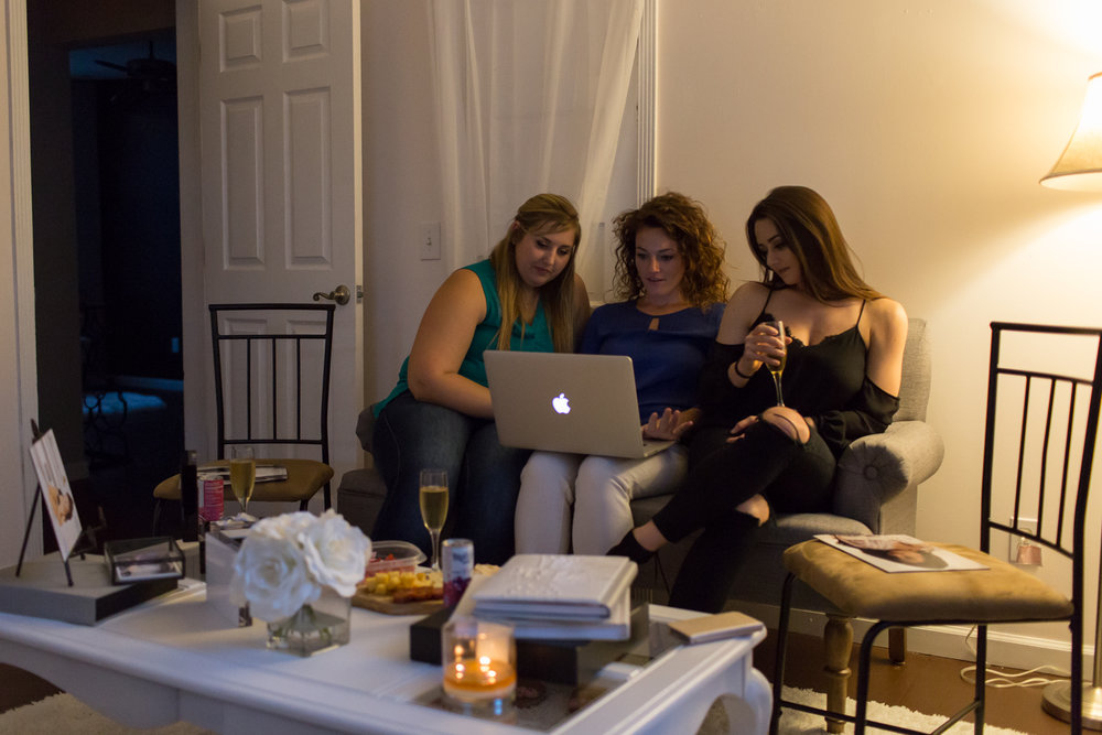 3 Women sitting on a couch looking at a computer