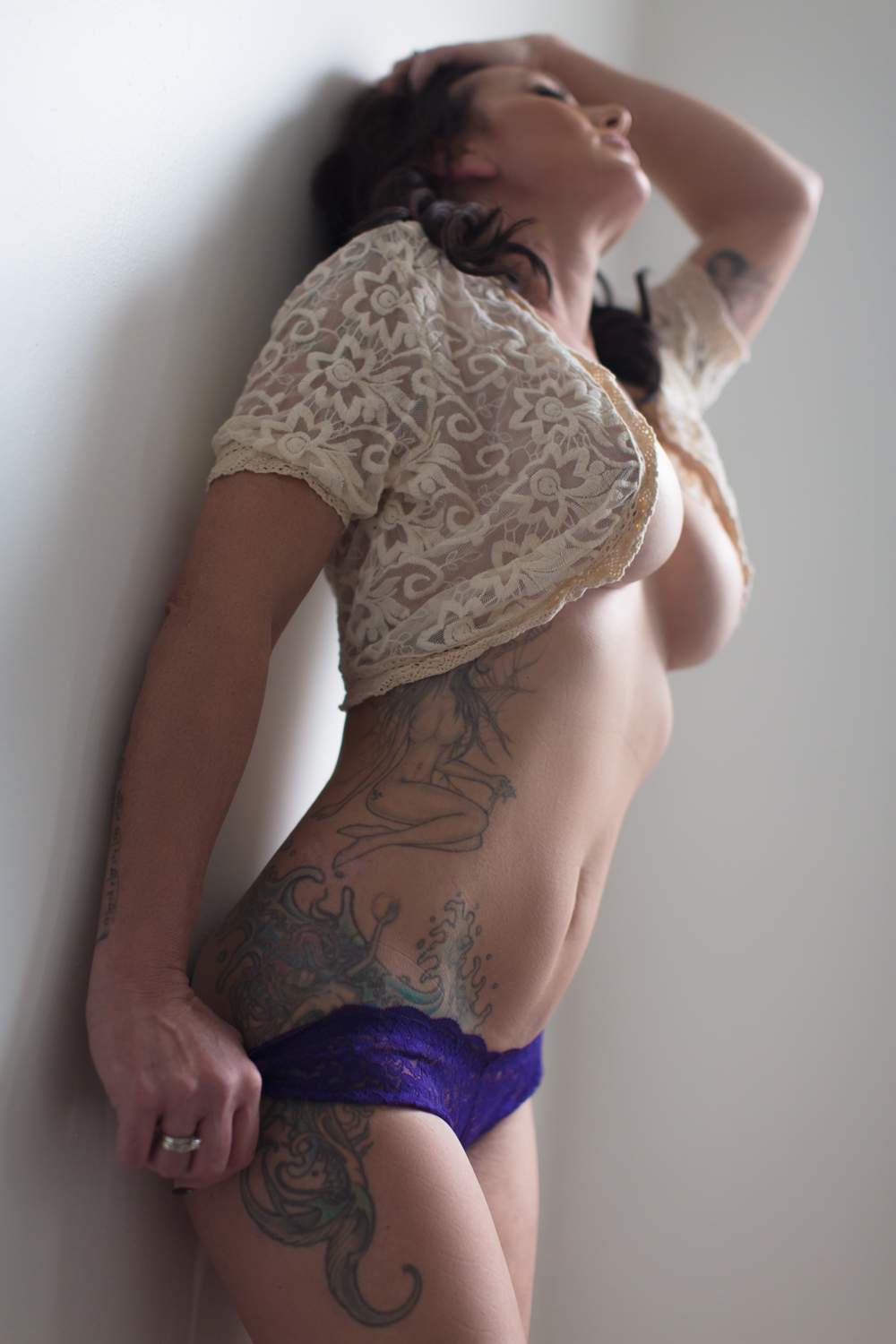 Mermaid side tattoo, sexy boudoir wall pose, side boob