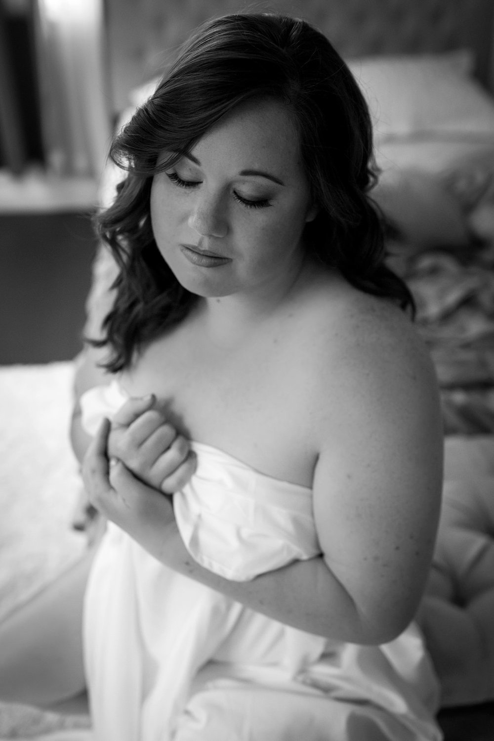 White sheet boudoir shot