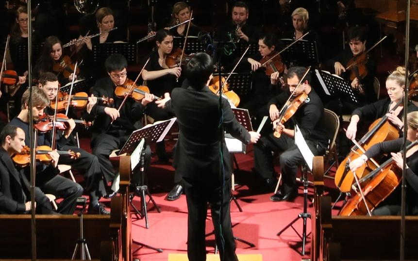 Mark Seto conducting the Chelsea Symphony