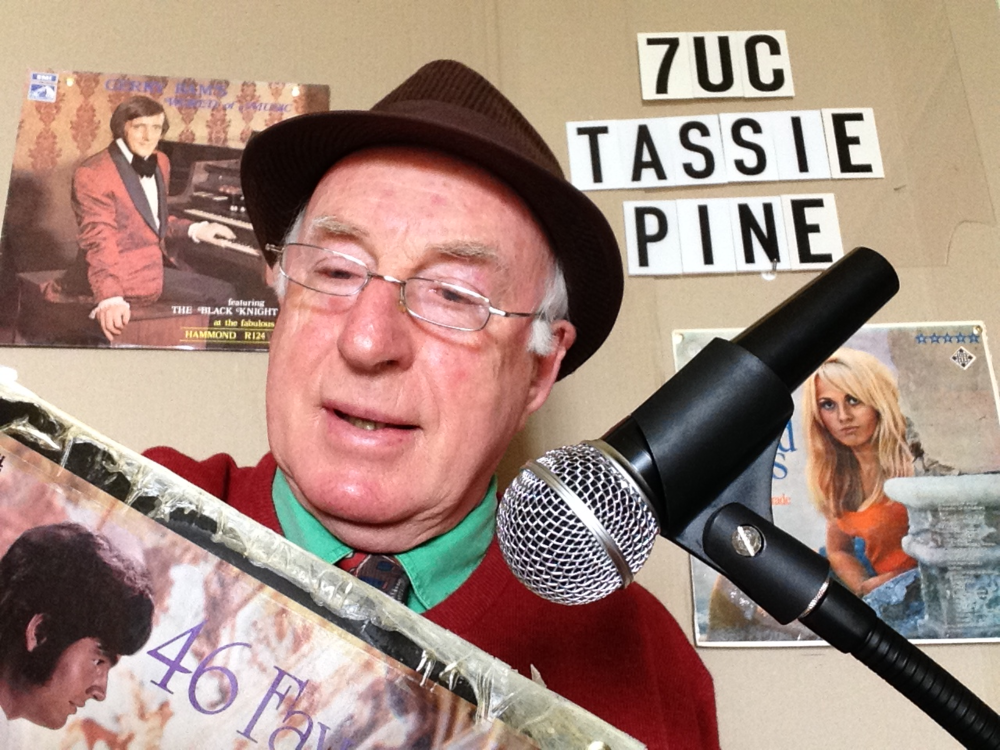 North West Farmer Takes Over Local Radio 7UC. Pictured is Tassie Pine and his favourite records,  Gerry Bam Plays the Hammond Organ  and  46 Favourite Waltzes  by the Promenade Strings.