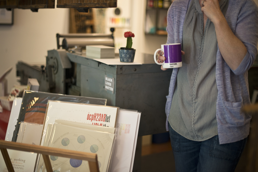 Mandolin Brassaw, owner of Grapheme, with Pantone tea and her letterpress.