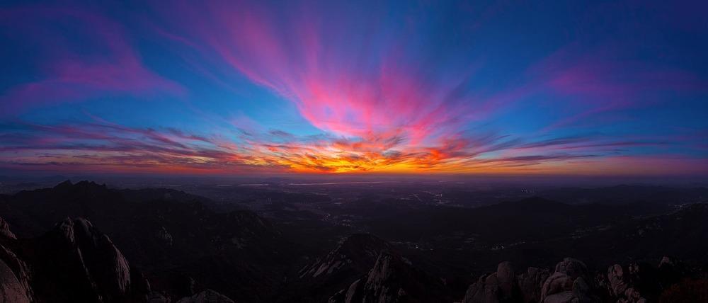 Sunset from Baegundae Peak atop Bukhansan Mountain. South Korea.