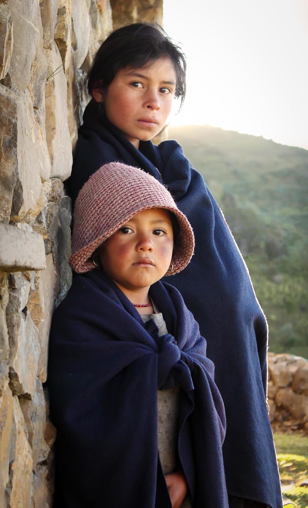 Children atop the Cuchumatanes mountain range. Guatemala.