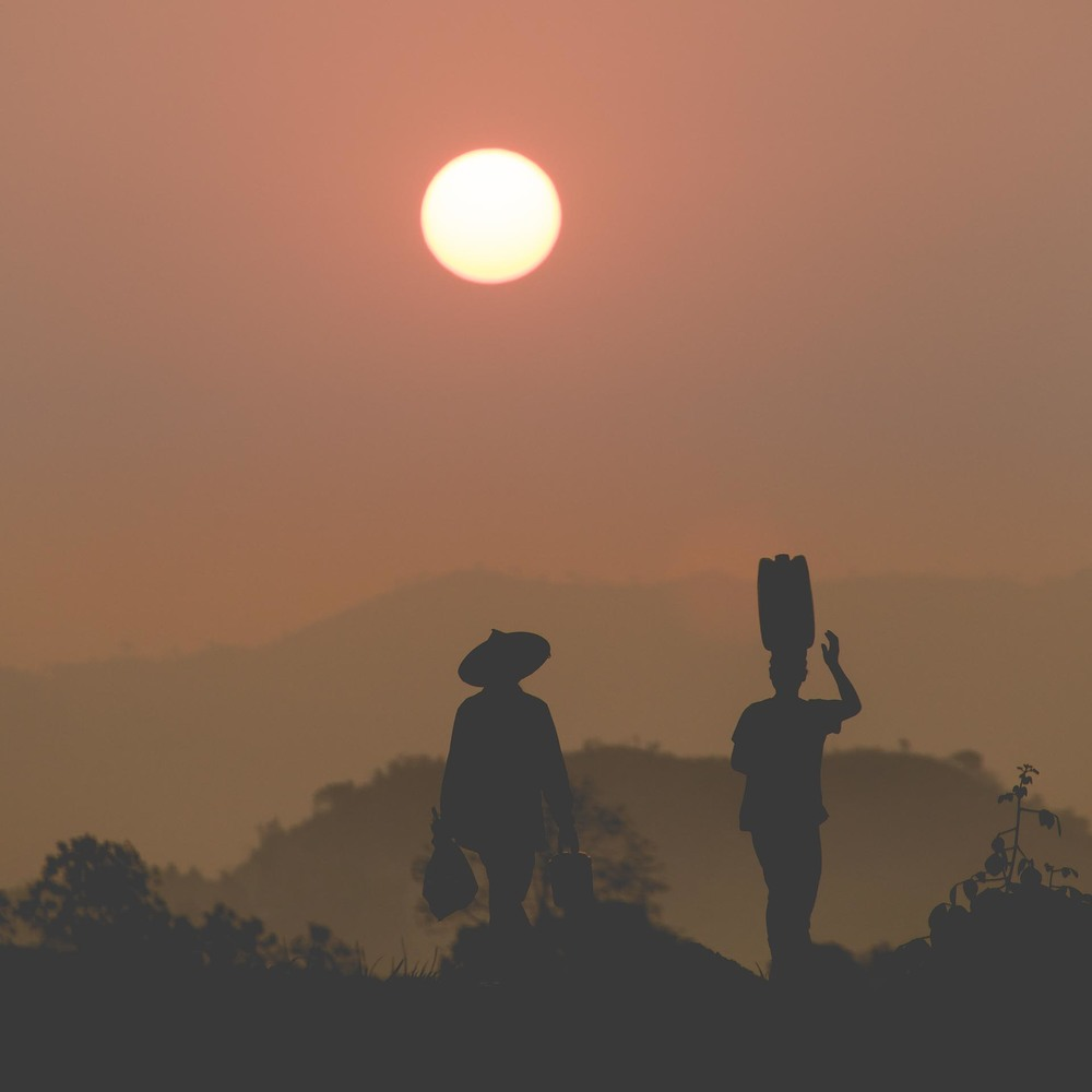 Road workers heading out at sunrise in Mrauk U. Myanmar