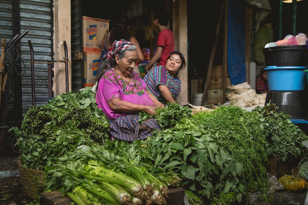 A lady selling fresh greens at La Terminal market in Guatemala City.