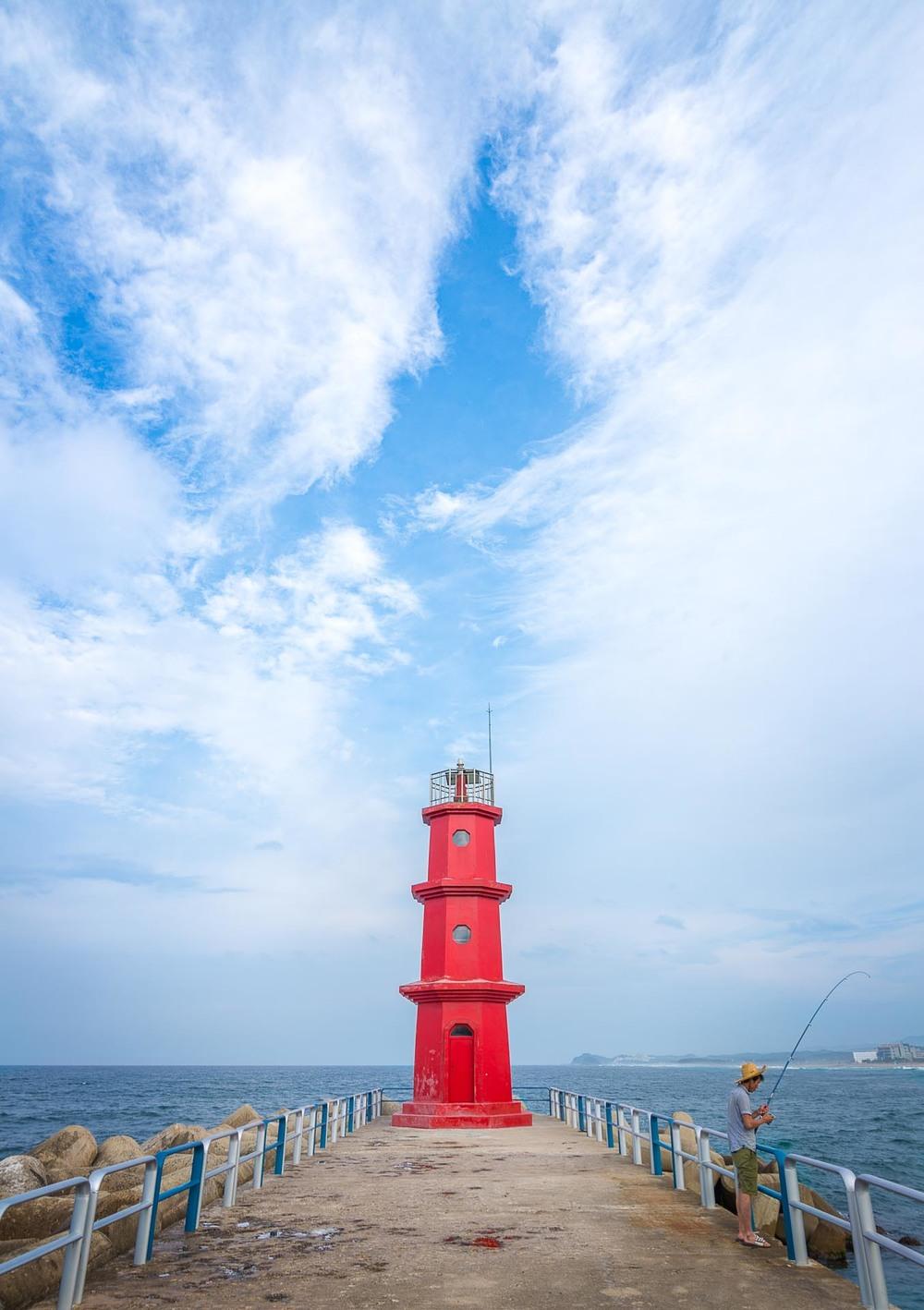 A small red lighthouse at Yang Yang beach. South Korea