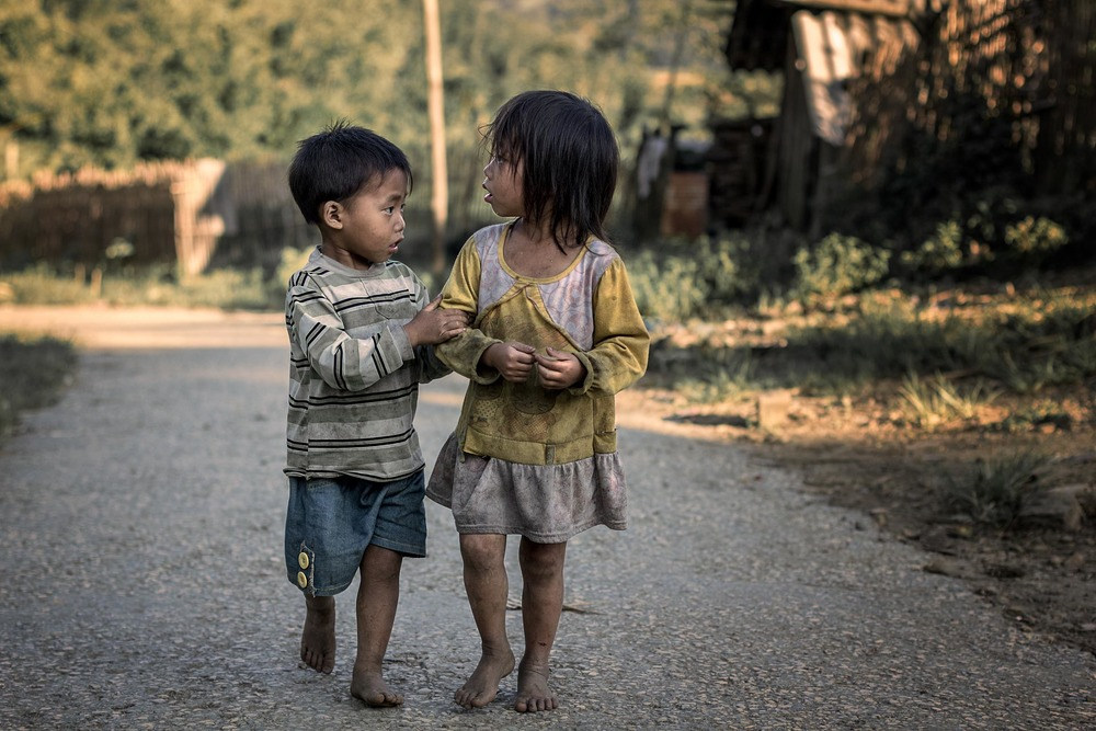 Children walking through rural Vietnam near Sa Pa.