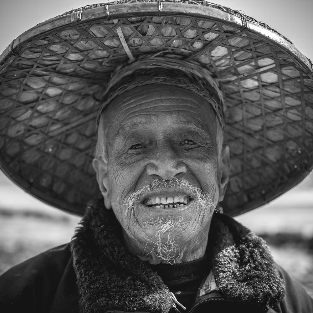 Elderly bird fisherman in Yangshuo. China