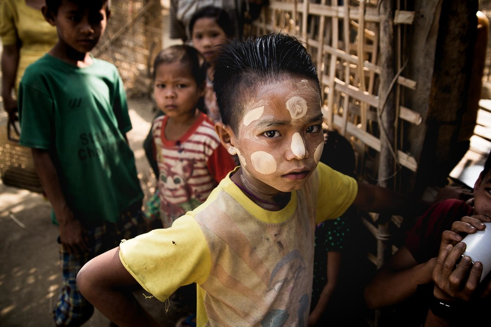 Chin boy with thanaka in a village in Rakhine State. Myanmar