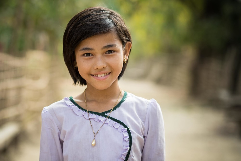Young Chin child in the national school uniform. Myanmar
