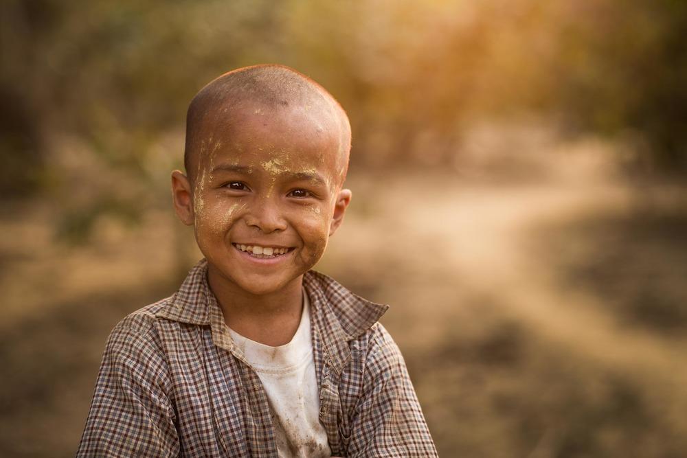 Chin child with thanaka in rural Rakhine state. Myanmar.