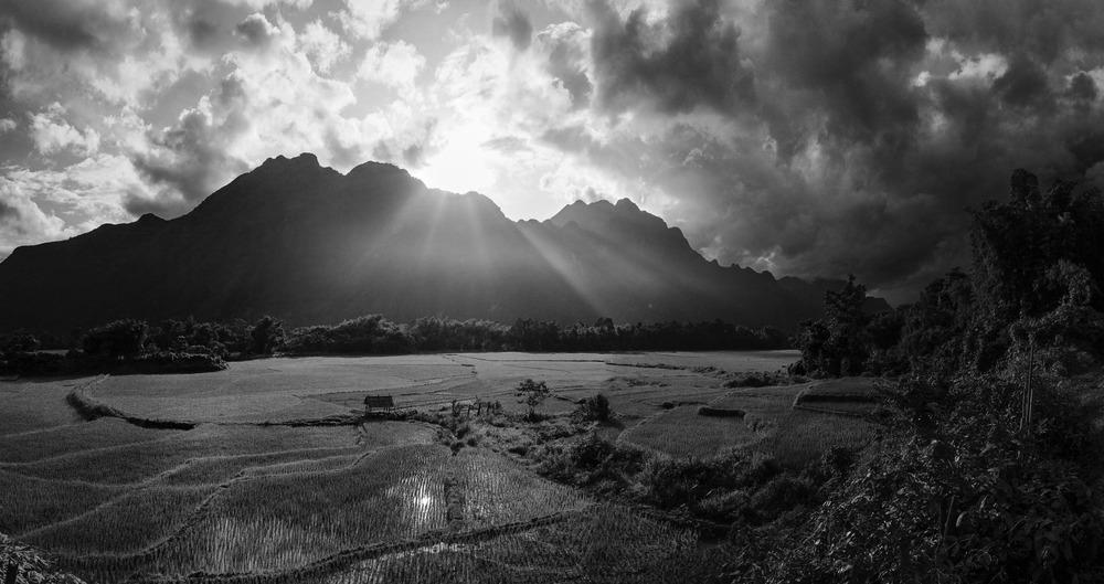 Rice paddies and mountains at sunset near Vang Vieng. Laos
