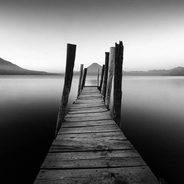 The following morning. . . . #guatemala #guateamala #perhapsyouneedalittleguatemala #centralamerica #visitguatemala #beautifuldestinations #passionpassport #instaguate #guatelinda #inspirationcultmag #fujifilmz #fujifilm_global #fujifeed #lake #atitlan #panajachel #nature #volcano #blackandwhite #fujifilmxt2 #dock #longexposure #slowshutterspeed