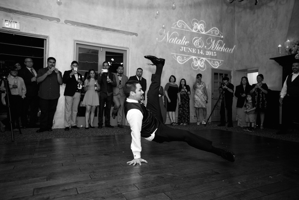 Groom and his groomsmen, who are all breakdancer's, take the floor and put on a great show.