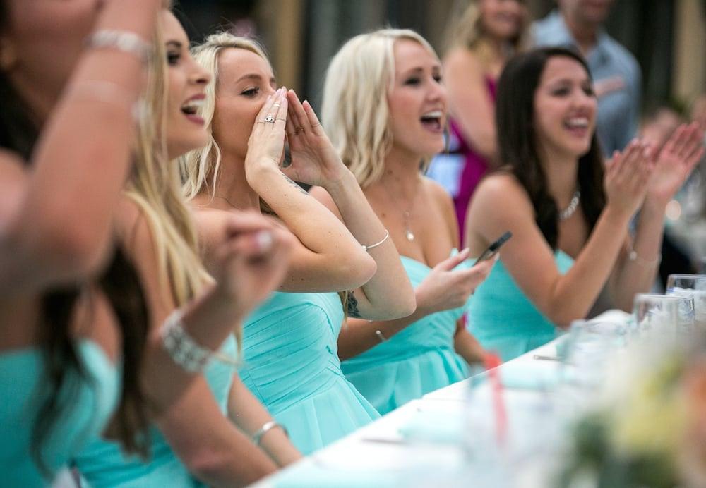 Bridesmaids cheering at Wedding Reception