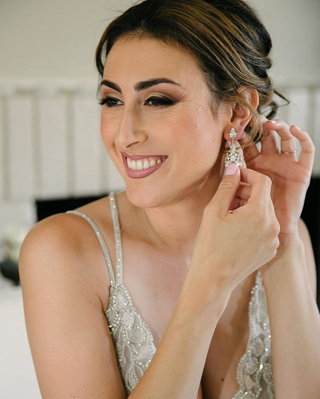 This stunning bride putting her earrings on during #gettingready #christopherbrownstudios
