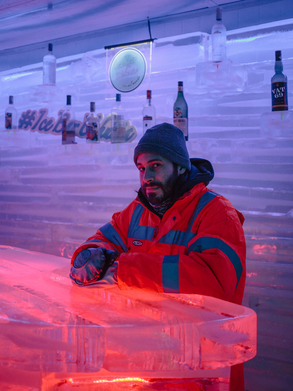 Santiago, bartender at the  Ushuaia Ice Bar . The temperature inside the bar is constantly kept around -17° and for this reason he can't work more than 30 minutes straight.