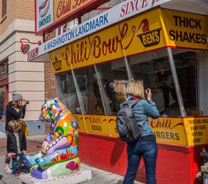 Mom photographers shoot through the glass into Ben's Chili Bowl while our 5 year old photographer investigated the painted panda. (c) Rebecca LaChance, 2015, Washington, D.C.