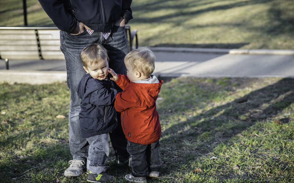 "You'd think this was a loving encounter between brothers.  In truth it was ""Twin Toddler Smackdown"". (c) Rebecca LaChance, 2016, Philadelphia, PA."