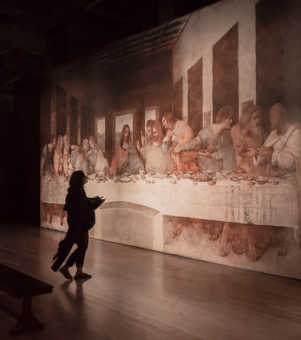 """She approaches the Last Supper"" (c) Rebecca LaChance, 2016. Kansas City, MO. An appropriate image for Easter season! Each of the 20 DaVinci masterpieces in the exhibit were projected onto a ""canvas screen"" the size of the original painting."