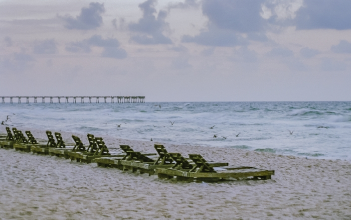 """Lonely Beach Chairs"" (c) Rebecca LaChance, 2015.  Panama City Beach, FL.  It's been a long hard season for these beach chairs."