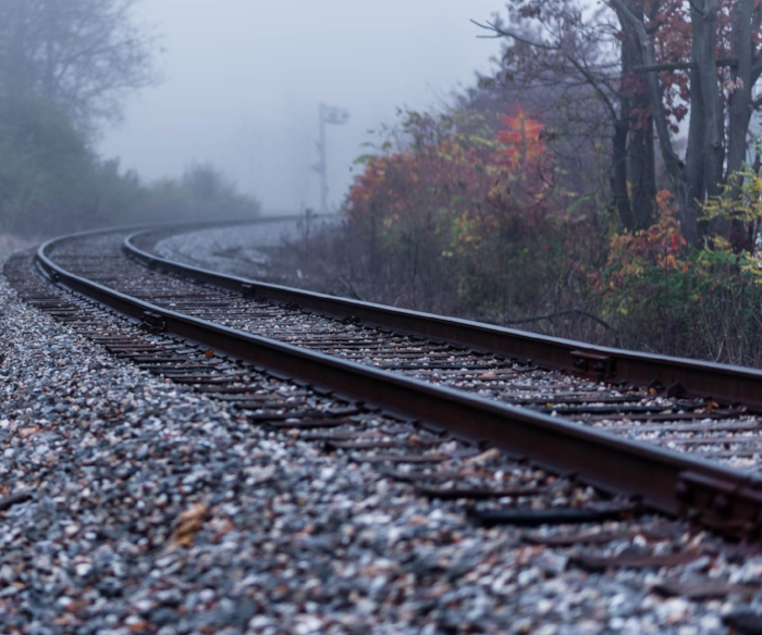 "Railroad track deliberately photographed so it was not all ""glowing and pretty"".  It is   NOT   to be used as a location backdrop for photography.  ""The Track next to the Church"" on a foggy morning from the parking lot that sits  next  to the tracks. Better to be alive and well - not a tragedy on the tracks. (c) Rebecca LaChance, 2015, Thurmont, MD."