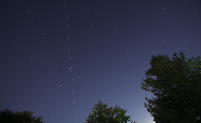The International Space Station traveling right over my house in 2014. (c) Rebecca LaChance, 2014, Thurmont, MD.  A good example of learning different photography technical skills in your own backyard. I use the ISS Spotter, an app that tracks the international space station.