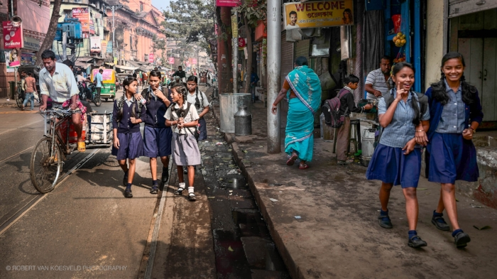 Heading to School, Kolkata  I like the challenge of finding several layers in an image. The eye can hunt around and be rewarded, just like we do naturally when 'people watching'