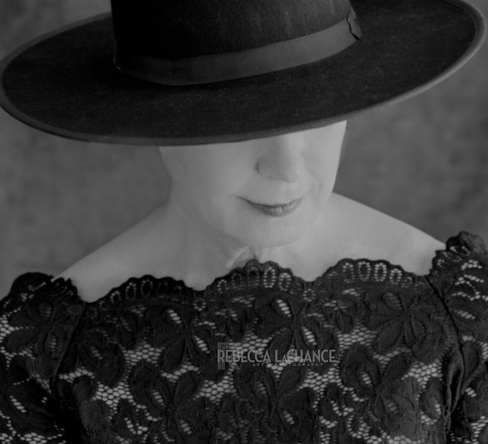 """Under the brim"" (c) Rebecca LaChance, 2017. Thurmont, MD.  Just because you're over 50 years of age doesn't mean you can't have a striking portrait. A black hat and black lace look good on women of experience and wisdom.  FYI, the woman in this portrait is 65.5 years of age."