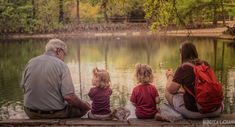 """Grandpa and the girls feeding the ducks."" (c) 2018, Rebecca LaChance. San Antonio, TX"