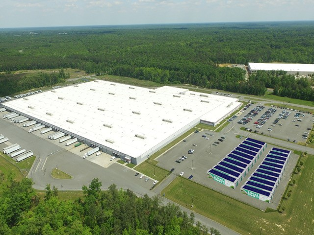 Concept image of Local Roots' business model to co-locate TerraFarms at retail distribution centers.
