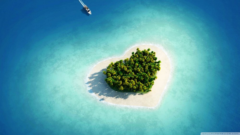 "CC image courtesy of Mehmet Canli ""aerial_view_of_heart_shaped_tropical_island-wallpaper-2400x1350"" on Flickr"
