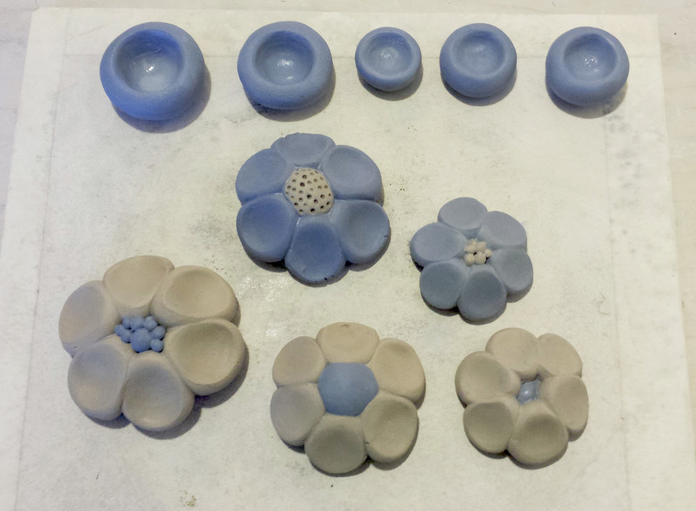 The flowers in process. I mixed powdered Mason stains to cone 10 porcelain.