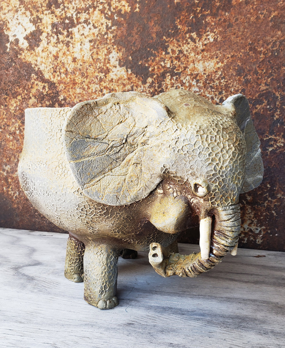A very cool elephant planter by a student