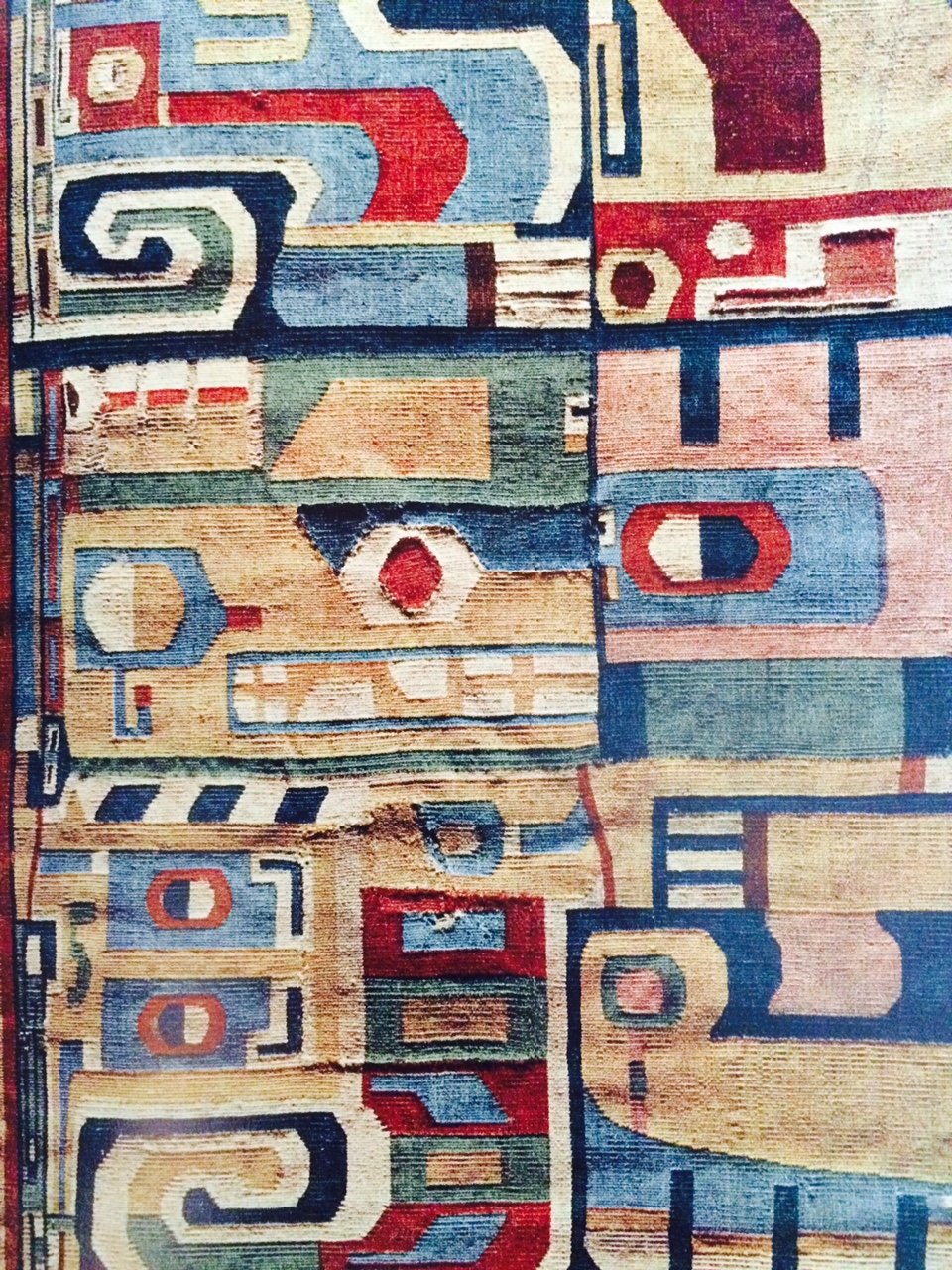 "Detail of fragment of poncho in tapestry weave with highly stylized feline design. Coast Tiahuanaco. 19 5/8"" wide. Collection: Nelson A. Rockefeller. Photo Nickolas Muray."