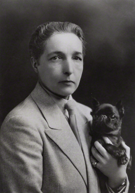 "Radclyffe Hall  (12 August 1880 – 7 October 1943)   Having reached adulthood without a vocation, she spent much of her twenties pursuing women she eventually lost to marriage.  In 1907 at the Bad Homburg spa in Germany, Hall met Mabel Batten, a well-known amateur singer of lieder. Batten (nicknamed ""Ladye"") was 51 to Hall's 27, and was married with an adult daughter and grandchildren. They fell in love, and after Batten's husband died they set up residence together. Batten gave Hall the nickname John, which she used the rest of her life.  In 1915 Hall fell in love with Mabel Batten's cousin Una Troubridge (1887–1963), a sculptor who was the wife of Vice-Admiral Ernest Troubridge, and the mother of a young daughter. Batten died the following year, and in 1917 Radclyffe Hall and Una Troubridge began living together. From 1924 to 1929 they lived at 37 Holland Street, Kensington, London.  The relationship would last until Hall's death. In 1934 Hall fell in love with Russian émigrée Evguenia Souline and embarked upon a long-term affair with her, which Troubridge painfully tolerated. She became involved in affairs with other women throughout the years."
