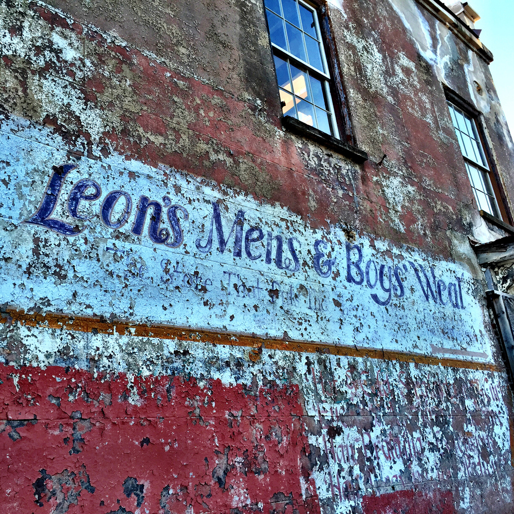 These old faded painted brick signs are often referred to as ghost signs.  Unfortunately I heard that this one is going to be removed.  A restaurant is being built in this building.
