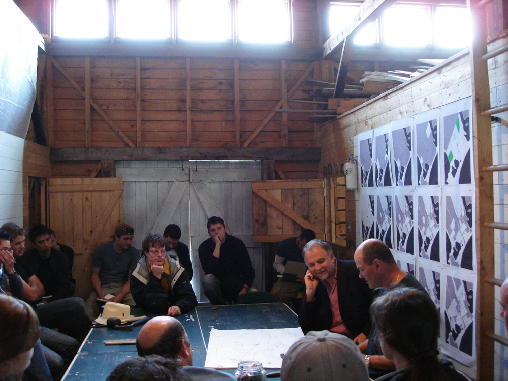A ping pong table was used as the main work surface.  On the far right is the architectural writer Peter Buchanan and Brian MacKay-Lyons.