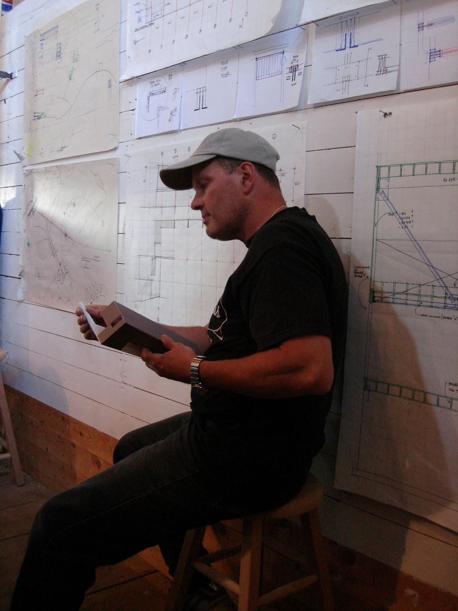 This was during one of the many pinup settings.  The working drawings were pinned up on the wall.  Scratch that.  They were nailed up on the wall.