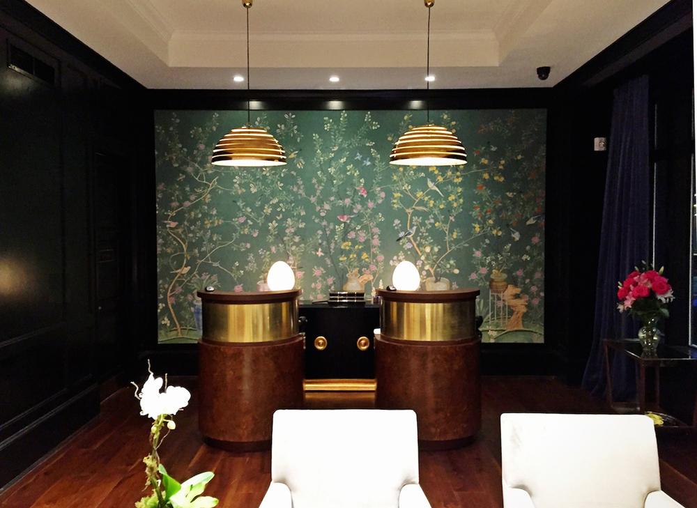 The reception kiosks at the Spectator were custom made for the hotel.  The light fixtures are vintage and the wall covering hand-painted.  Every piece is extremely custom.