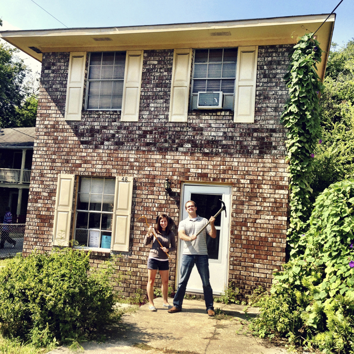 I love this photo.  This was the day that we bought our first house.  We were so happy and we had no idea what we had gotten ourselves into.  We literally went inside that day, drank some champagne and immediately started tearing down the ceilings.  And look how ugly that house is! I get happy looking at this pic.