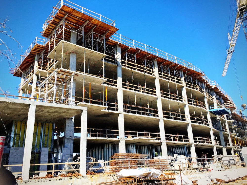 Tides IV Condominium - Construction pic showing 5 floors of concrete poured with the 6th floor formwork in place.
