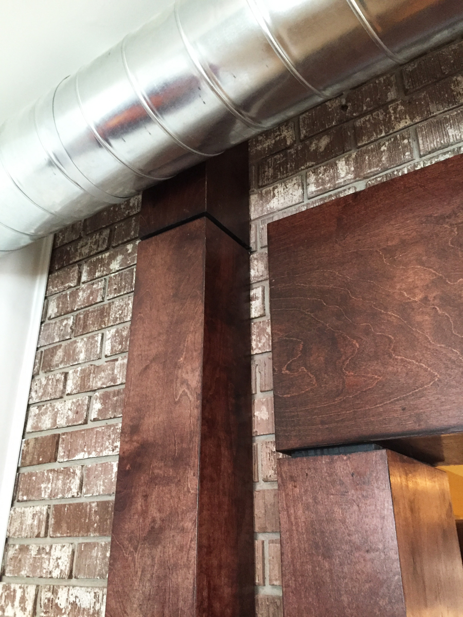 A detail photo from our home addition.  I am happy to boast that we have exposed ductwork, exposed structural columns and exposed brick.  Livin' the dream!