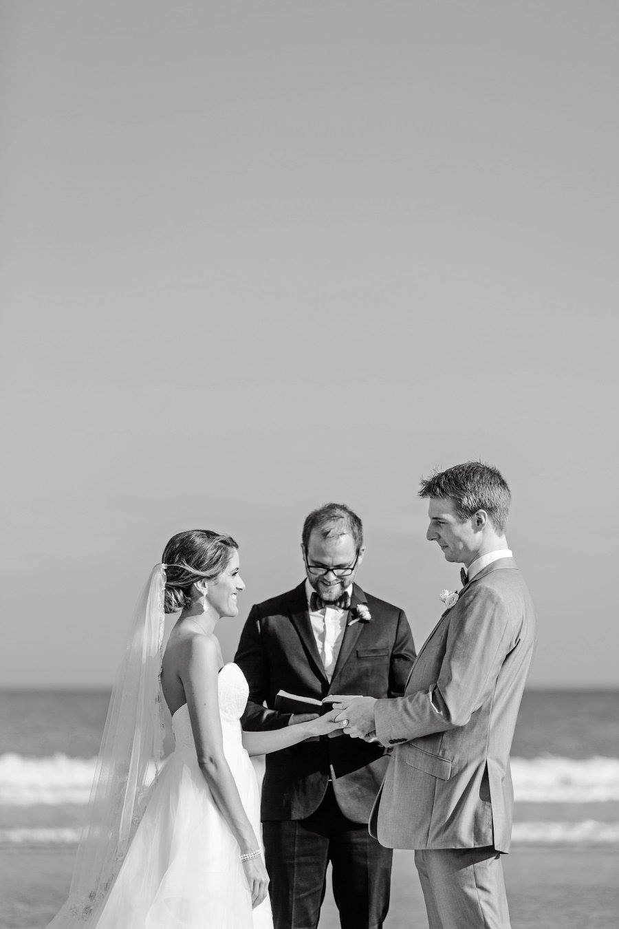 That is my sister Michelle and her husband David.  And me officiating their wedding with my moleskin sketchbook.  Photo credit:  Shannon Michele Photography
